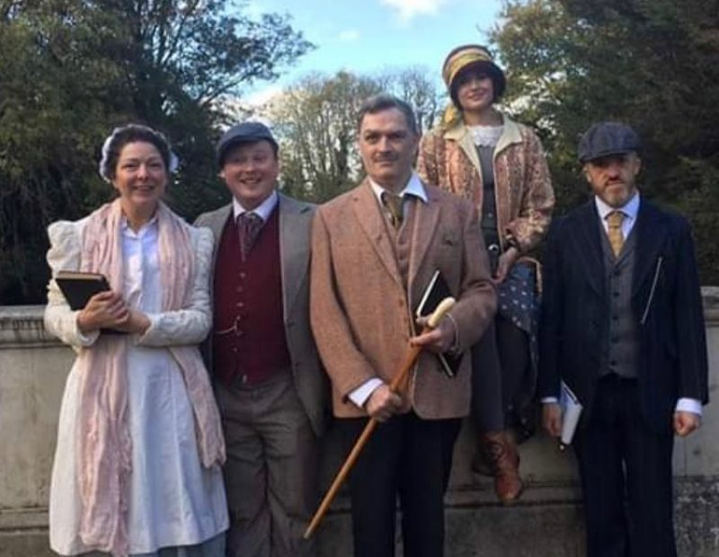 A group of 5 people pose in Edwardian Costume
